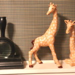 Decorative Painted Giraffes With Large Magnifying Glass