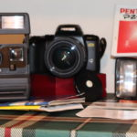 Assorted Cameras Includes Pentax PZ 70, Canon ELPH 260-Z And Polaroid Cameras