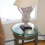 Beveled Glass Top Ornate Metal Base End Table And Carved Basketweave Grecian Urn Style Table Lamp